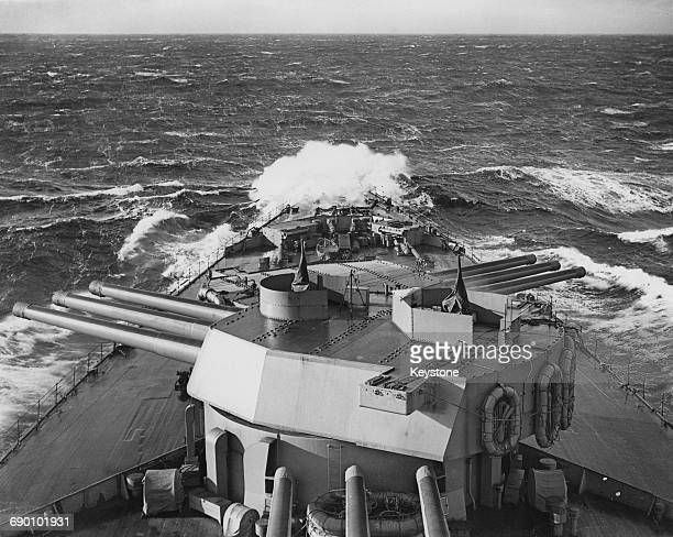 The barrells of the main armament of nine 16inch guns mounted in triple turrets on the Royal Navy Nelsonclass battleship HMS Rodney are elevated...