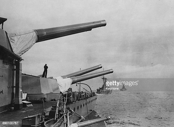 The barrells of the main armament of the four twin 15inch guns on the Royal Navy Queen Elizabethclass battleship are elevated whilst cruising line...