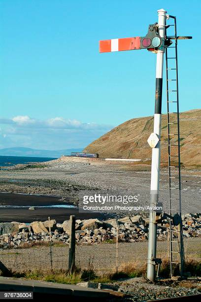 The barrenness of the Cumbrian Coast is emphasised in this view of a Class 156 Sprinter on a Carlisle Barrow service approaching Parton under the...