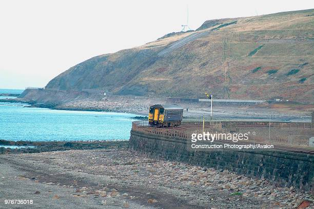 The barrenness of the Cumbrian Coast is well seen as a single Class 153 unit curves into Parton with a Whitehaven Carlisle local passenger service...