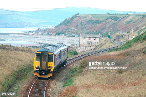 The barrenness of the Cumbrian Coast is well seen at Nethertown as a Class 156 Sprinter unit curves into view with a Carlisle Barrow service October...