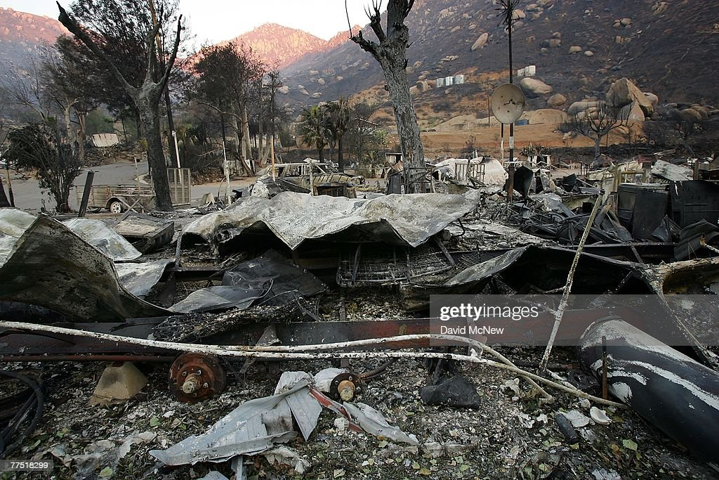 The Barrett Lake Resort Mobile Home Park smolders in ruins from the burning of the 75,000-acre Harris Fire October 26, 2007 near Barrett Junction, west of Portrero, California. The Harris Fire was in an area woven with foot trails of generations of illegal US-Mexico border crossers where Border Patrol agents have found the bodies of suspected illegal immigrants, three men and a woman, they believe died. Previously hidden under thick underbrush, the migrant trails are now easily seen in the desolate and blackened land that was stripped by the fire. A border patrol agent patrolling the area said the denuded landscape will give border crossers fewer hiding places. In the past, major fires have made it easier too see migrants, but it can make it harder to catch them as they are no longer confined to a limited number of paths. Southern California has been suffering the worst wildfire event in state history, fed by strong Santa Ana Winds blowing numerous fires across dry native Chaparral habitat that was desiccated by the driest rain season since records began 130 years ago.