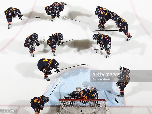 The Barrie Colts practice a drill in the warmup prior to an OHL game against the London Knights on November 30 2012 at the Budweiser Gardens in...