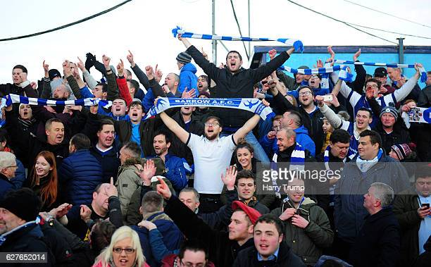 The Barrow FC fans celebrate victory during the Emirates FA Cup Second Round match between Bristol Rovers and Barrow FC at the Memorial Stadium on...