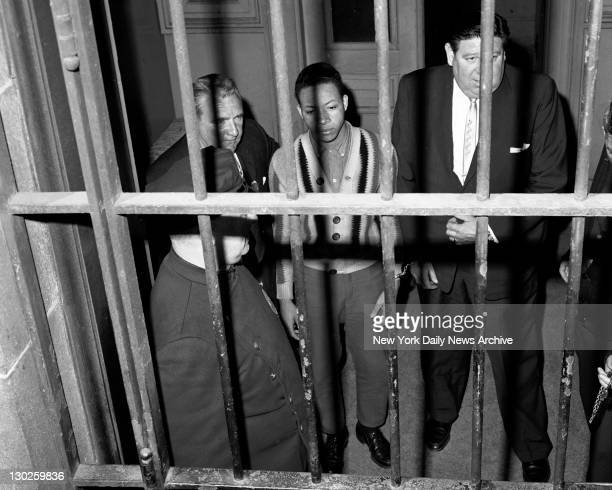 The Bars Of Justice Accused slayer George Whitmore Jr is led from Police Headquarters to be arraigned in the stab killings of Janice Wylie and Emily...