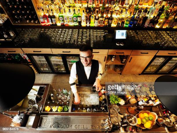 The bartender is seen behind the counter Restaurant Rooster Grill in downtown Kiev opened a new hightech bar This is the only bar in the capital of...