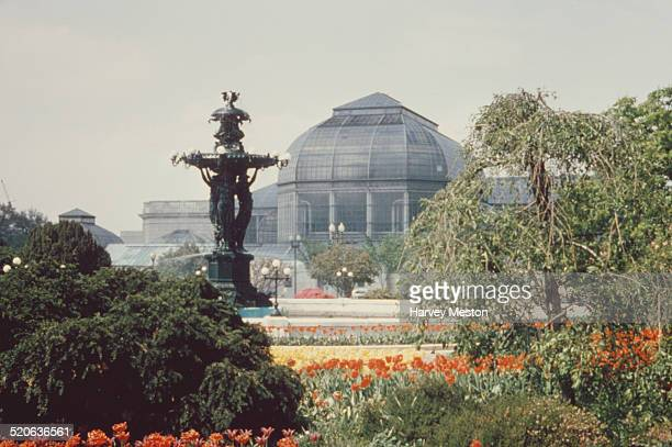The Bartholdi Fountain in the United States Botanic Garden, with the conservatory behind, Washington, DC, USA, circa 1960.