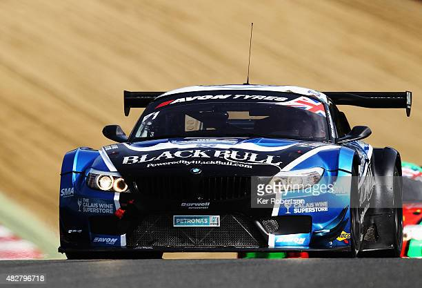 The Barwell Motorsport Ecurie Ecosse BMW Z4 of Marco Attard and Alexander Sims drives on its way to winning the British GT Championship race at...