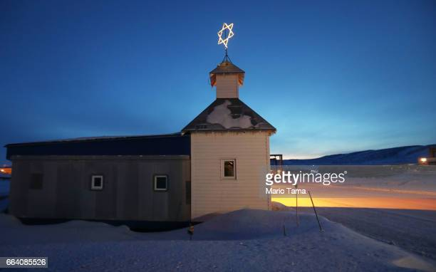 The base chapel stands at dusk at Thule Air Base on March 29, 2017 in Pituffik, Greenland. NASA's Operation IceBridge is flying research missions out...