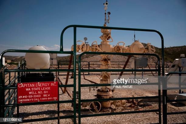 """The base of a """"Christmas Tree"""", which is installed at the top of a fracking well is pictured at Capitan Energy on May 7, 2020 in Culberson County,..."""