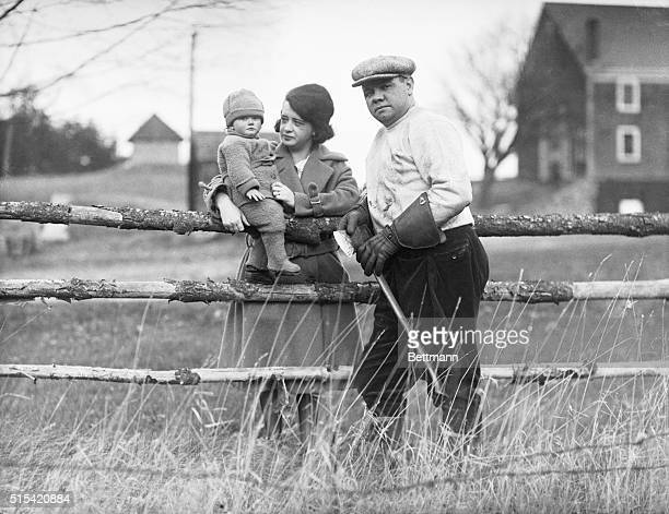 The baseball champion, Babe Ruth, posing at his Sudbury, Massachusetts, farm with his wife and baby daughter, Dorothy, on December 2, 1922.