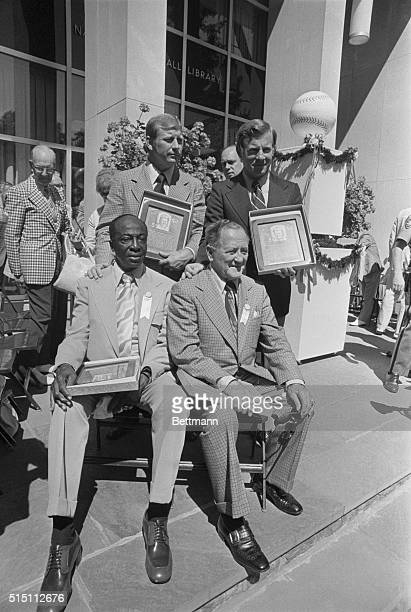The Baseball Hall of Fame's newest members display their plaques after being inducted to the Hall. Standing left to right are Mickey Mantle and...