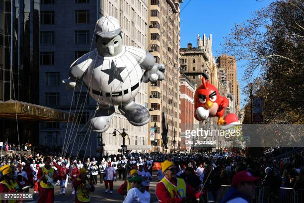The Baseball Player Angry Birds and SpongeBob SquarePants balloons float down Central Park West during the 91st Annual Macy's Thanksgiving Day Parade...