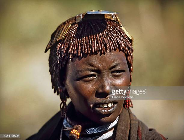 The Bashada tribe lives in the EastOmo valley between Turmi and Dimeka They mix ochre water and binding resin and then rub the mixture into their...