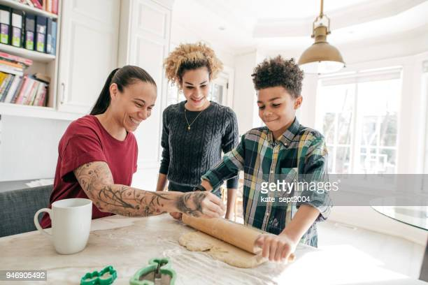 the basics of baking - family with one child stock pictures, royalty-free photos & images