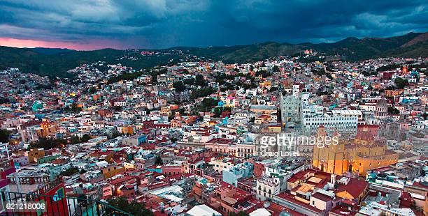 The Basilica Colegiata de Nuestra Senora de Guanajuato glows at dusk from the towns overlook - GUANAJUATO, MEXICO