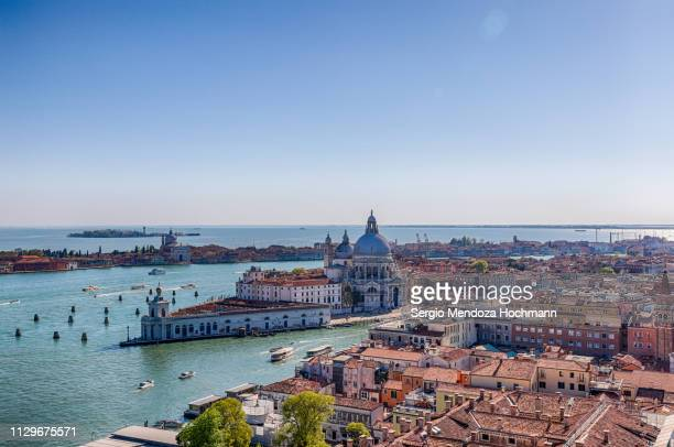 the basilica di santa maria della salute - venice, italy - punta della dogana stock photos and pictures