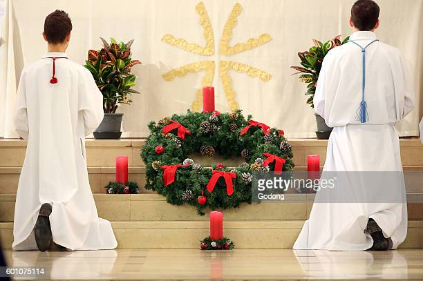 The Basilica of the Visitation Advent wreath and altar boys Annecy France