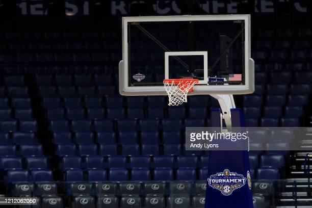 The basket and the arena sit unused after the announcement of the cancellation of the SEC Basketball Tournament at Bridgestone Arena on March 12,...