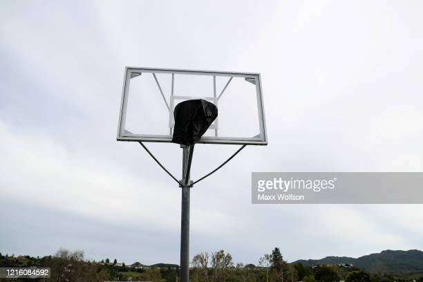 The basketball hoops at Berniece Bennett Park are covered up with a tarp to prevent people from gathering and playing basketball on March 31 2020 in...