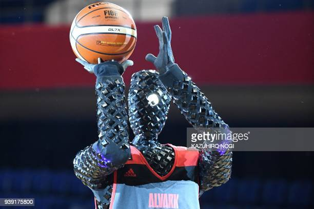 TOPSHOT The basketballplaying robot named CUE prepares to shoot the ball during a halftime show rehearsal for a Japanese B League basketball match in...