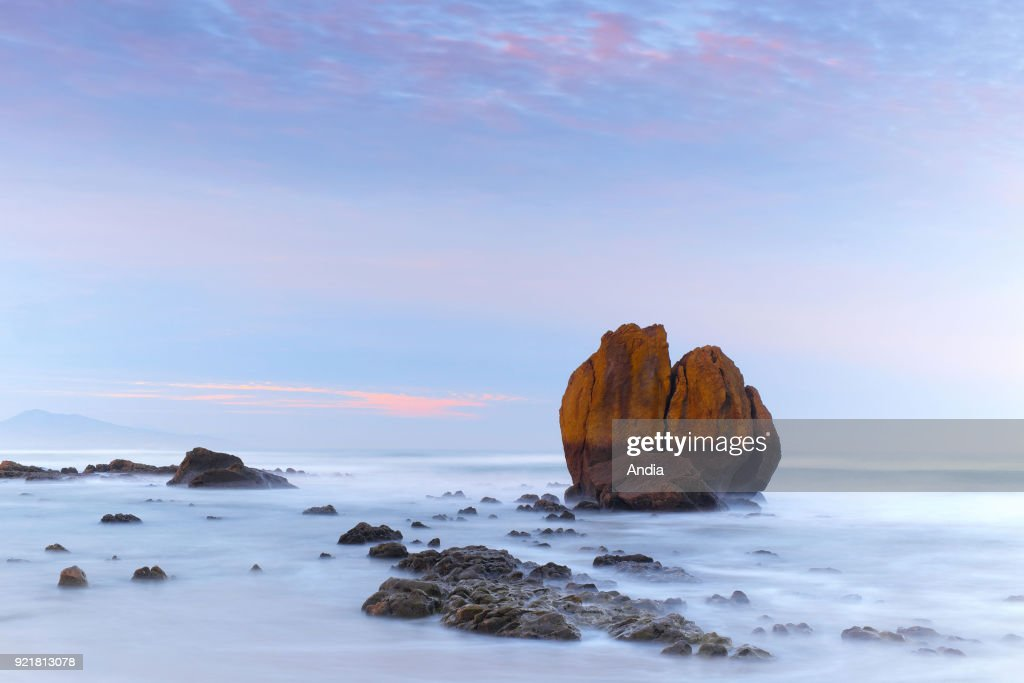 The Basque Coast and rocks at low tide, in Biarritz, Ilbarritz Beach (south-western France). Rocks on the beach of Ilbarritz at sunrise.