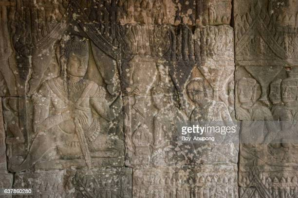 the bas-relief of king jayavarman vii at the outer corner of bayan temple of angkor thom, cambodia. - khmer art stock photos and pictures
