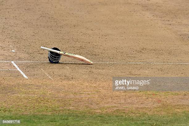The bat and helmet of Indian cricketer Lokesh Rahul is seen kept on the field as he takes a break during the twoday tour match between India and WICB...