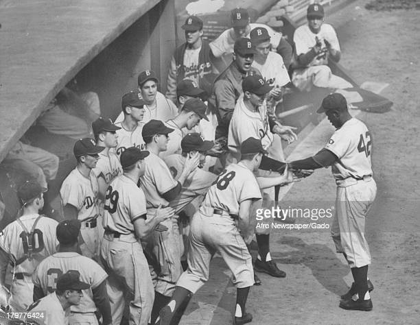 The bat of American baseball player Jackie Robinson of the Brooklyn Dodgers is not enough as giants take death game 1949
