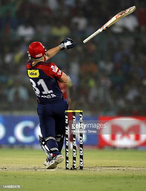 The bat of Delhi Daredevils batsman David Warner slipped out of his hands while playing a shot against Royal Challengers Bangalore in IPL T20 match...