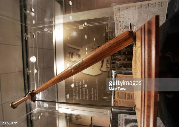 The bat which Babe Ruth used to hit the first home run in Yankee Stadium is seen at a Sotheby's preview of a baseball memorabilia sale titled The...