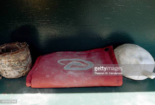The bat wieght rosin bag and pinetar rag belonging to the Arizona Diamondbacks sits in the dugout prior to the start of the game against San...