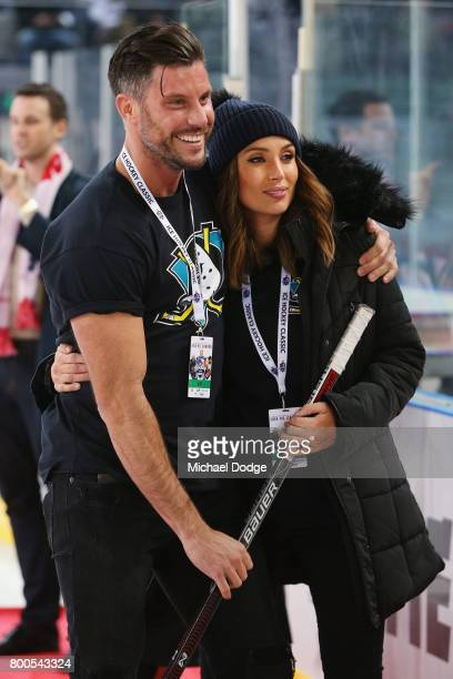 The Batchelor Sam Wood is seen with Snezana Markoski during the Ice Hockey Classic match between the United States of America and Canada at Hisense...