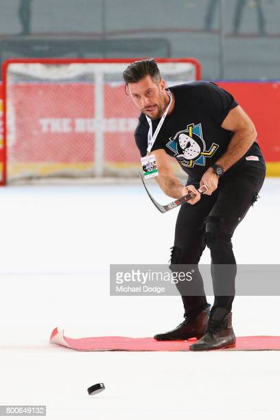 The Batchelor Sam Wood takes part in a half time activation during the Ice Hockey Classic match between the United States of America and Canada at...