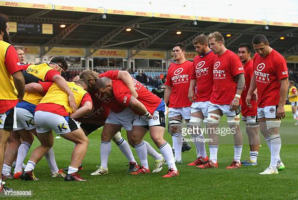 The Bath forwards prepare to scrummage wearing the Restart Rugby T shirt in the warm up during the Aviva Premiership match between Harlequins and...
