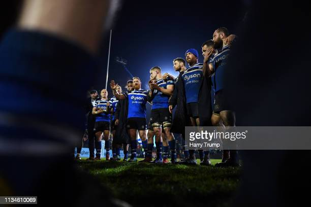 The Bath Rugby side hold a post match huddle during the Gallagher Premiership Rugby match between Bath Rugby and Saracens at Recreation Ground on...