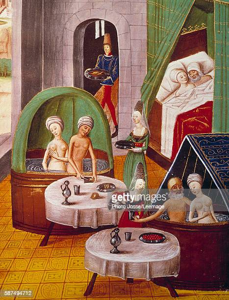 The Bathhouses View of the Interior of a brothel nude couples eating and drinking in bathtubs another couple is in a bed Miniature from The Book of...