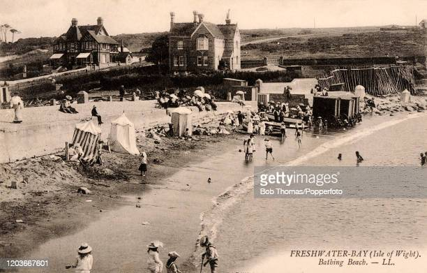 The bathing beach at Freshwater Bay, on the Isle of Wight, circa 1910.