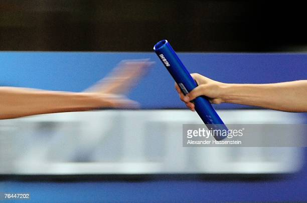 The baton is seen being passed during the Women's 4 x 400m Relay Heats on day eight of the 11th IAAF World Athletics Championships on September 1...