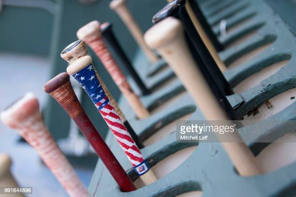 The bats of the Baltimore Orioles in the dugout prior to the game against the Philadelphia Phillies at Citizens Bank Park on July 4 2018 in...