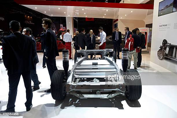 The battery and chassis of a Tesla Model S automobile produced by Tesla Motors Inc sits on display at the Paris Motor Show on the final preview day...