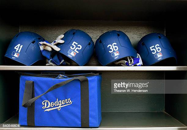 The batting helmets belonging to the Los Angeles Dodgers sits in the rack prior to the start of the game against the San Francisco Giants at ATT Park...
