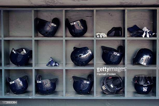 The batting helmets belonging to the New York Yankees are seen before the game between the Minnesota Twins and the New York Yankees on July 1 2013 at...