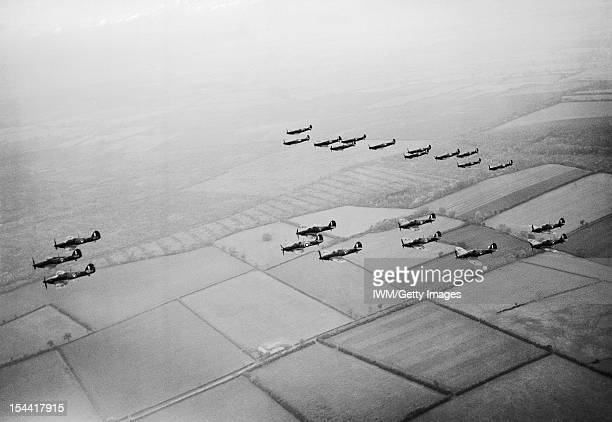 The Battle Of Britain 1940 A formation of Hawker Hurricanes of No 1 Squadron RAF lead Supermarine Spitfires of No 266 Squadron during a flying...