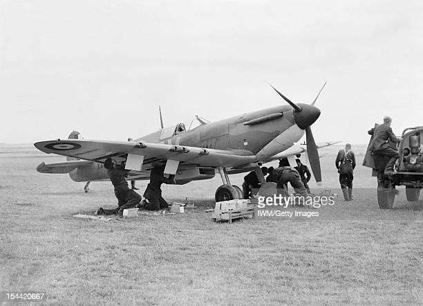 The Battle Of Britain 1940 A Supermarine Spitfire Mark 1A of No 19 Squadron Royal Air Force being rearmed between sorties at Fowlmere Cambridgeshire...