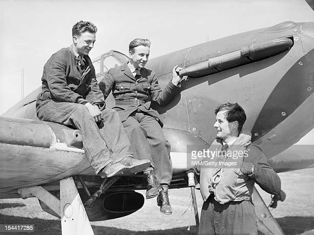 The Battle Of Britain 1940 British Personalities Squadron Leader Peter Townsend DSO DFC chatting with ground crew who are seated on his Hawker...