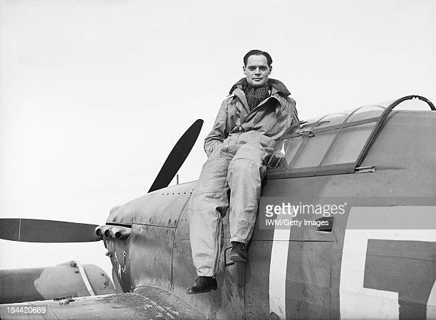 The Battle Of Britain 1940 British Personalities Squadron Leader Douglas Bader DSO DFC CO of 242 Squadron Royal Air Force seated on the cockpit of...