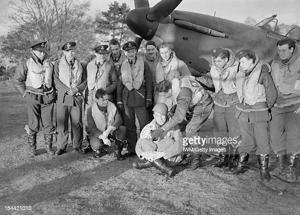 The Battle Of Britain 1940 British Personalities Squadron Leader Stanford Tuck poses with a group of pilots of 257 Squadron Royal Air Force under the...