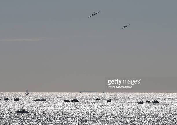The Battle of Britain Memorial Flight Spitfire and Hurricane fly overhead as the 'Little Ships' depart from Ramsgate for Dunkirk on May 21 2015 in...