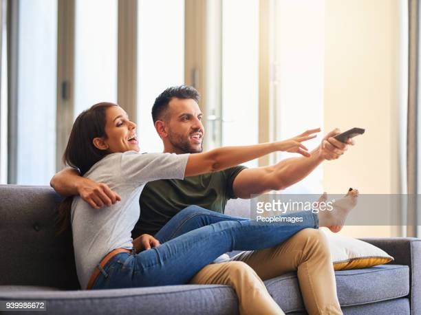 the battle of choosing what to watch - girlfriends films stock pictures, royalty-free photos & images